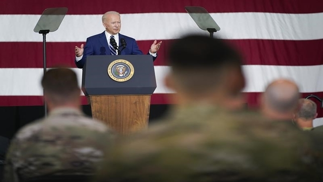 Biden marks vaccine progress, thanks troops ahead of holiday