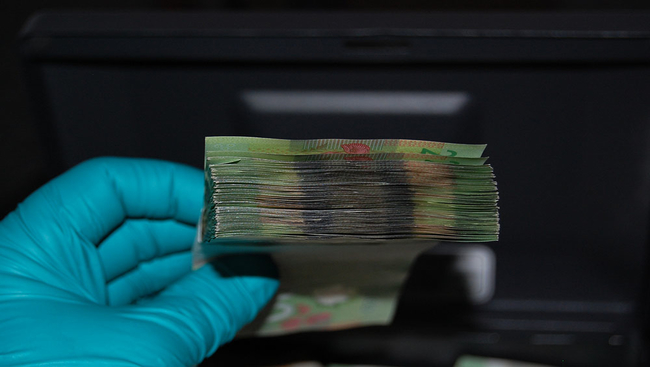 Coquitlam RCMP want to return a stack of cash, similar to this stack of 20-dollar bills, to its rightful owner