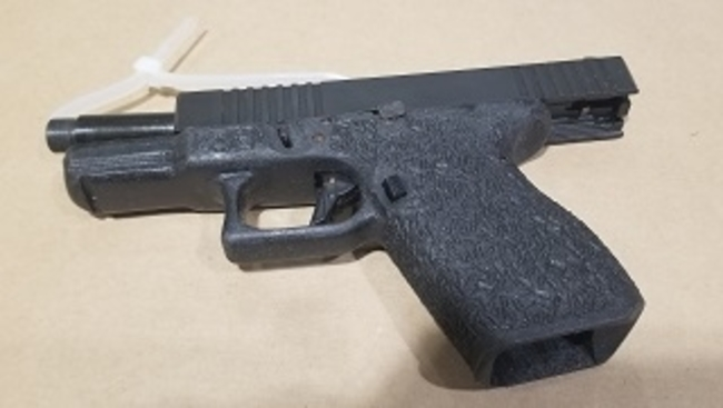 Gang enforcement team arrest man with loaded firearm and jerrycan