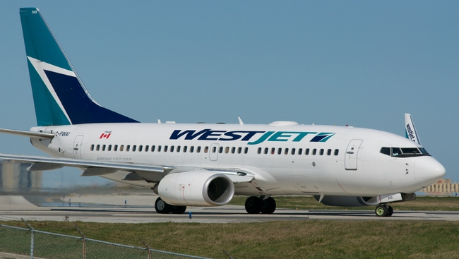 West Jet removes seats for Canada Day dropping physical distancing