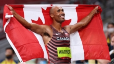 Canadian Damian Warner wins gold in decathlon at Tokyo Olympics, earns title of world's greatest athlete