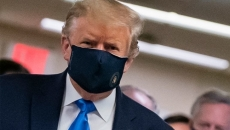 US President Donald Trump seen wearing a mask in public for the first time.