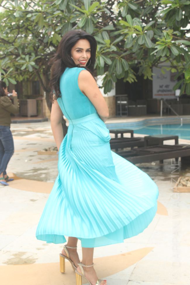 Mallika Sherawat is a cool sight in aqua dress paired with gold high heels