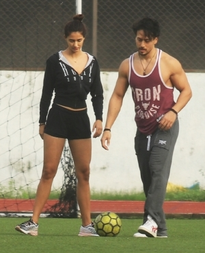 Tiger Shroff kicks the ball with girlfriend Disha Patani