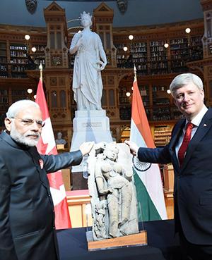 Canada returns Indian heritage piece - Parrot Lady. PM Modi receives sandstone sculpture from Khajuraho.