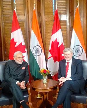 India's PM Modi & Canada's PM Stephen Harper have a Tete-a-tete.