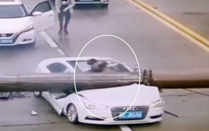 Man In China Miraculously Survives After A Crane Falls On His Car