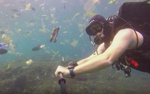 WATCH: Diver Recording Sea Creatures Swim Through Waste Dumped In The Ocean